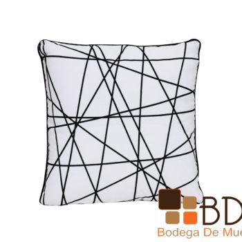 Cojin decorativo con lineas negras sobre fondo blanco